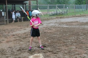 Gracie batting in the mud